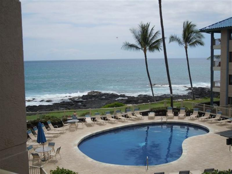 Condo overlooks pool and ocean