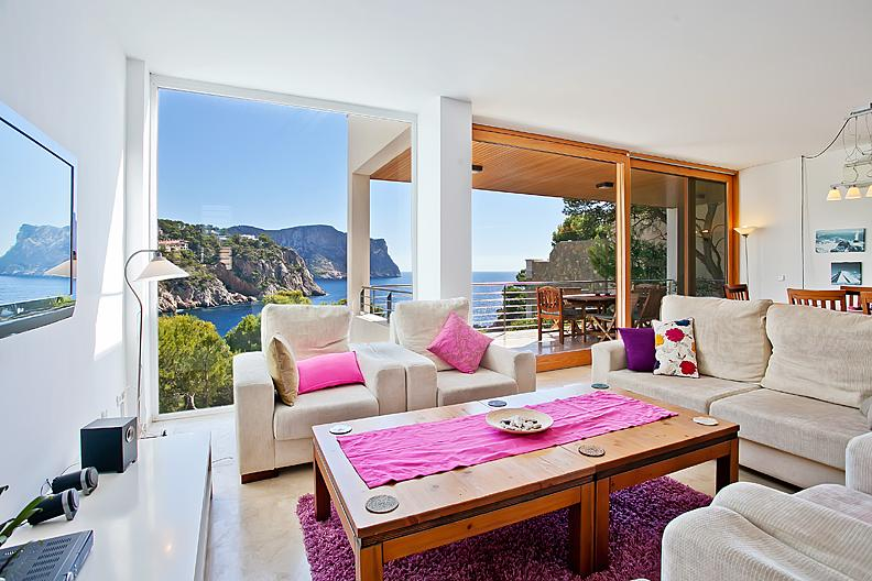 Living/Dining Room with floor to ceiling windows offering panoramic sea  views