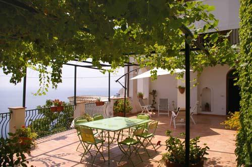 large terrace overlooking the sea equipped with table and chairs