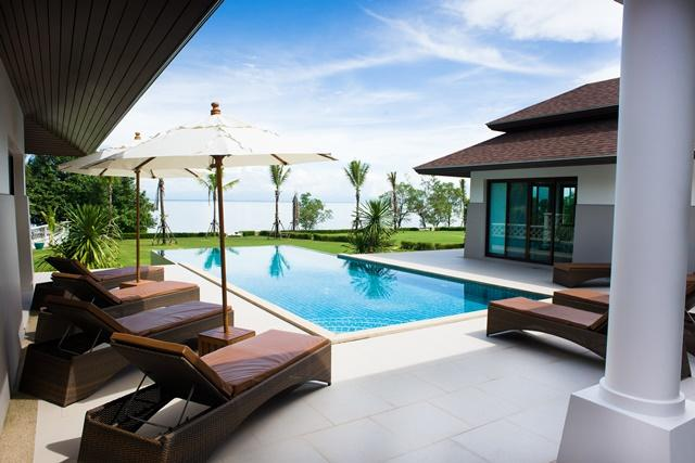 Outside patio, infinity swimming pool and sea view.