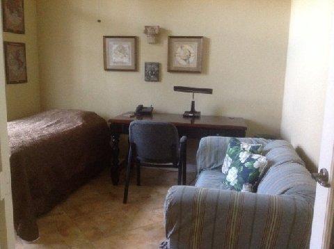 DEN w/ single bed, office desk, TV, sofa