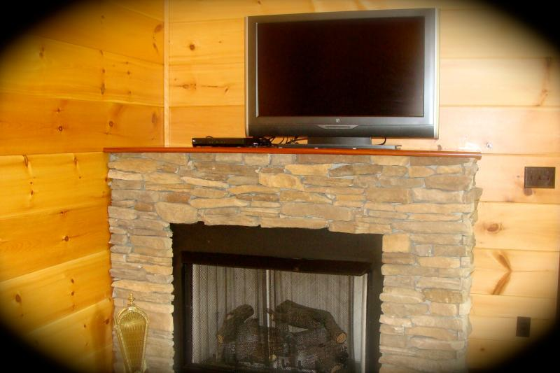 Two stone fire places with gas logs and flat screen tv's, satillite service.