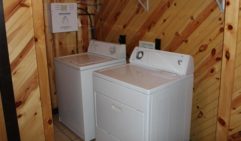 full size washer/ dryer in separate laundry room with extra fridge