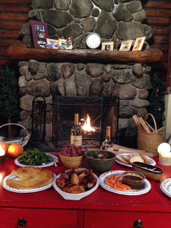 Romantic feast in front of the fire