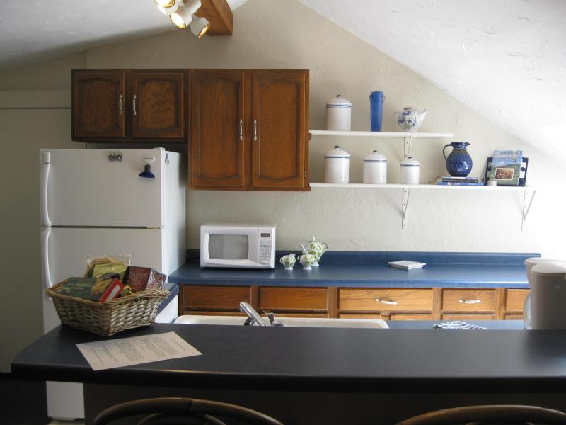 Full kitchen features breakfast bar, dishwasher and washer/dryer.