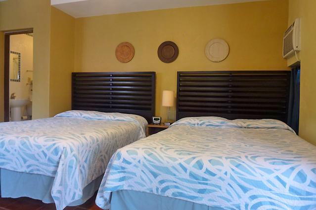 The cozy studio features 2 comfortable Queen-size beds