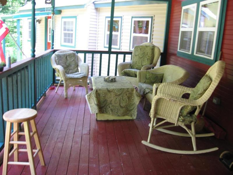 Farmers Porch, Wicker Furniture and gas grill, also have two pic nic tables at fire pit.