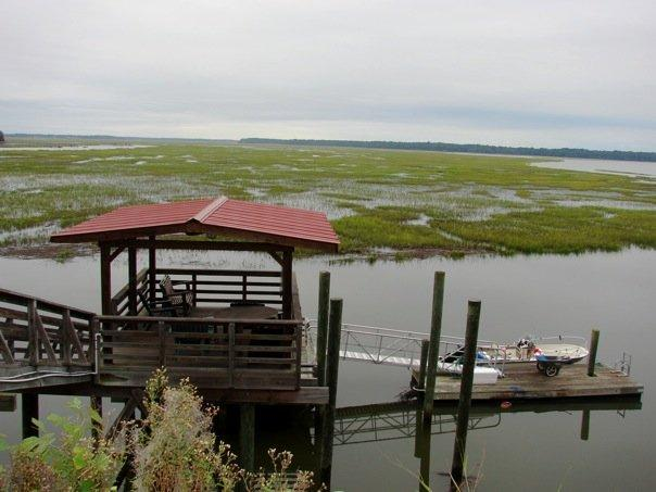 Top dock with water, sink, lights, fan, table and chairs, fish cleaning station.