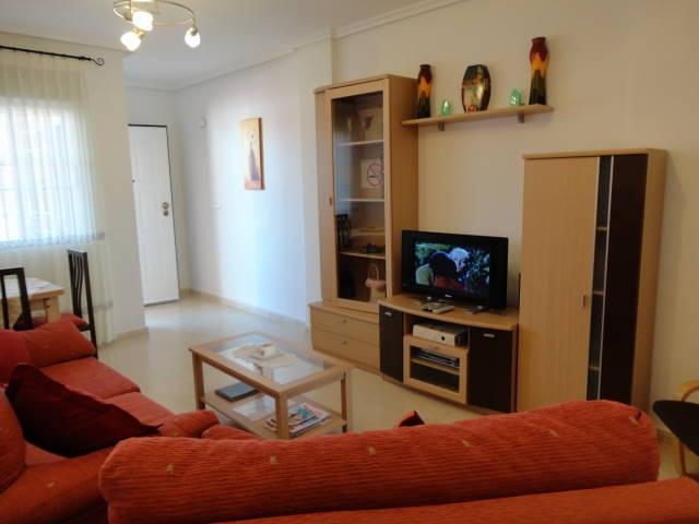 Lovely ground floor, light & airy 2 bed apartment with wifi. Large sun terrace, vacation rental in Punta Prima