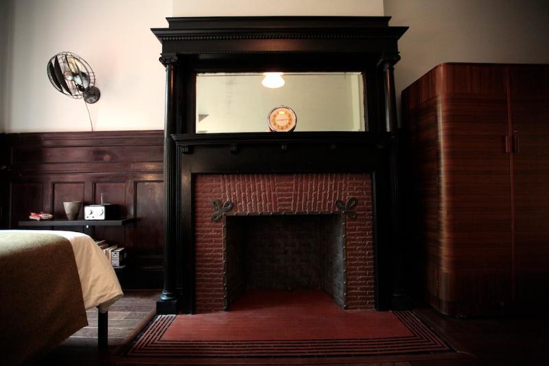 Bedroom decorative fireplace.