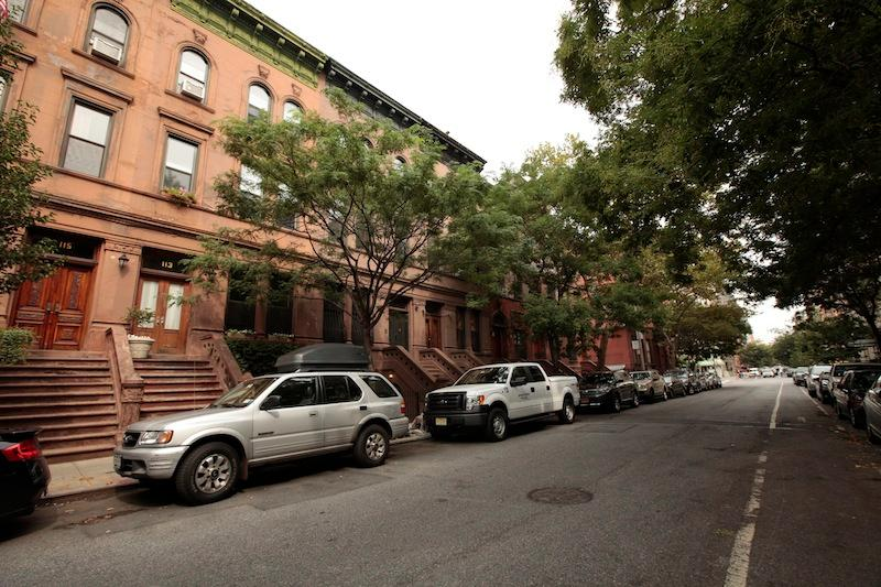 Quiet tree-lined historic block.