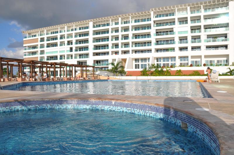 hot tub and pool.  our place is on top floor just to left of the center of  the building