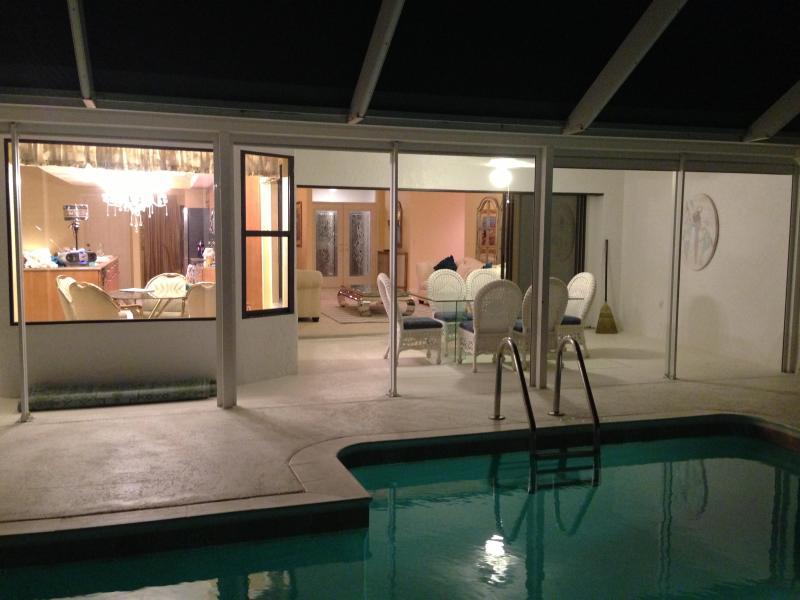pool looking toward family room and breakfast area