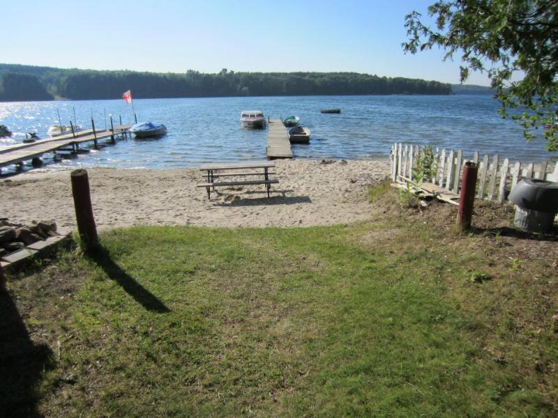 Access to small stretch of beach across road on local lake. Shallow sandy entry for swimming