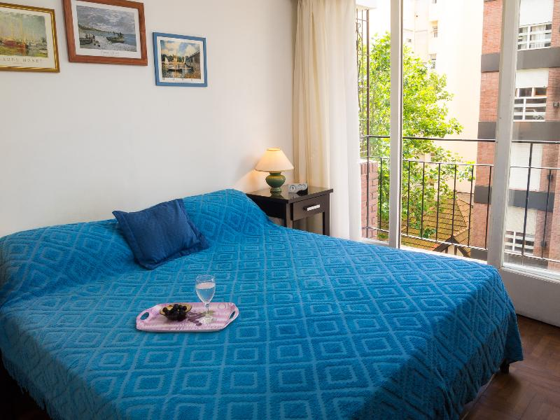 Comfortable bedroom with two single beds that can be joined. TV and DVD with movies.