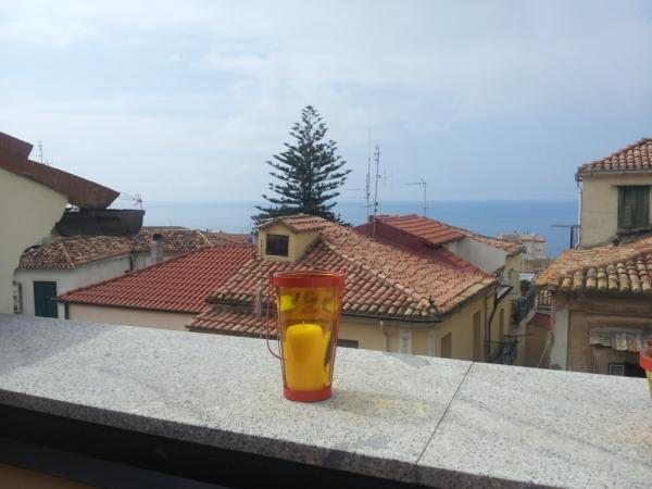 view from the sun terrace over roof tops out to sea