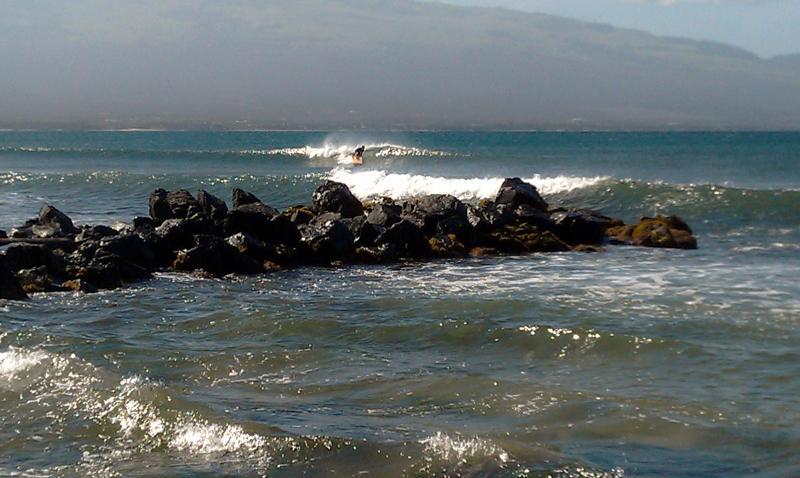Surfing off Sugar Beach