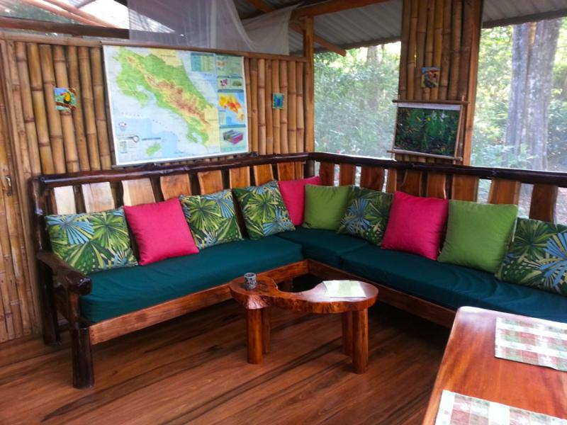 sofa with ocean and jungle view