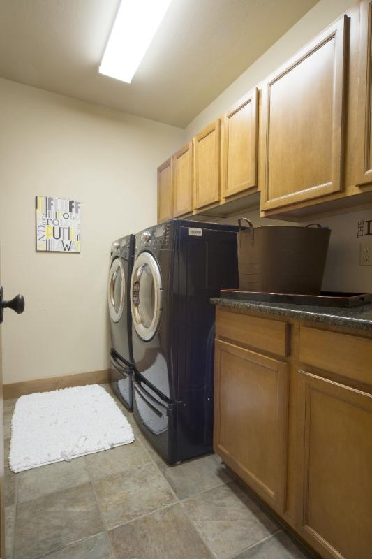 Full size front loading washer and dryer for your use.