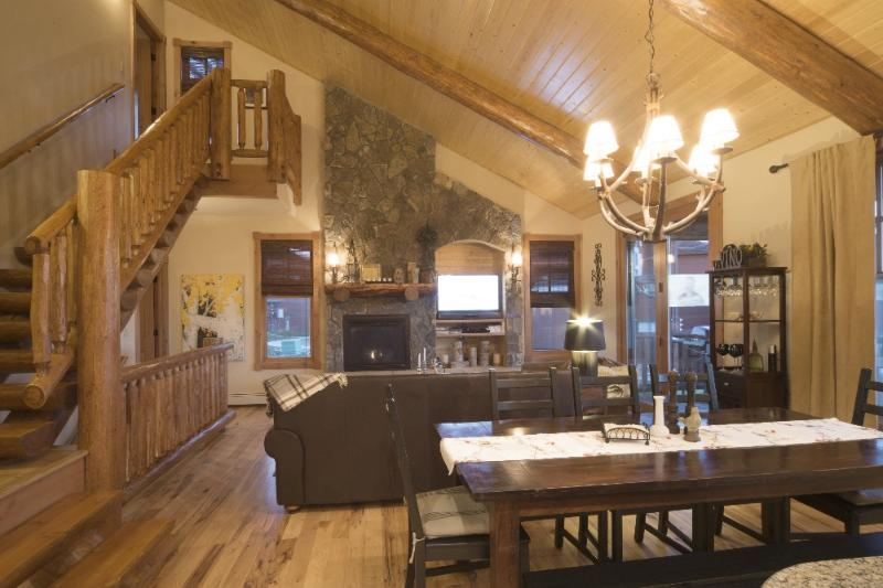Open concept family room and kitchen with beautiful vaulted wood ceilings!