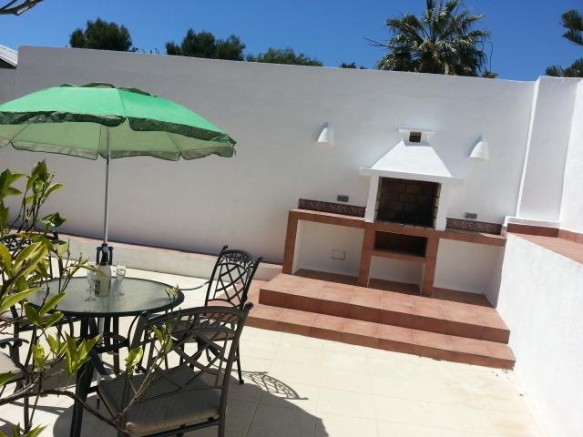 Or have a barbecue: eat, drink and enjoy the new terraced area behind the villa.