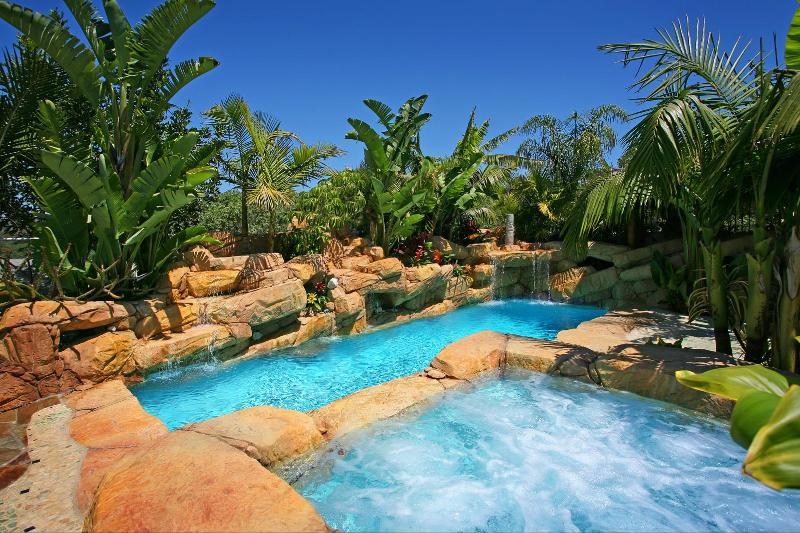 Solar Heated private pool and large spa in a tropical lagoon setting & waterfalls