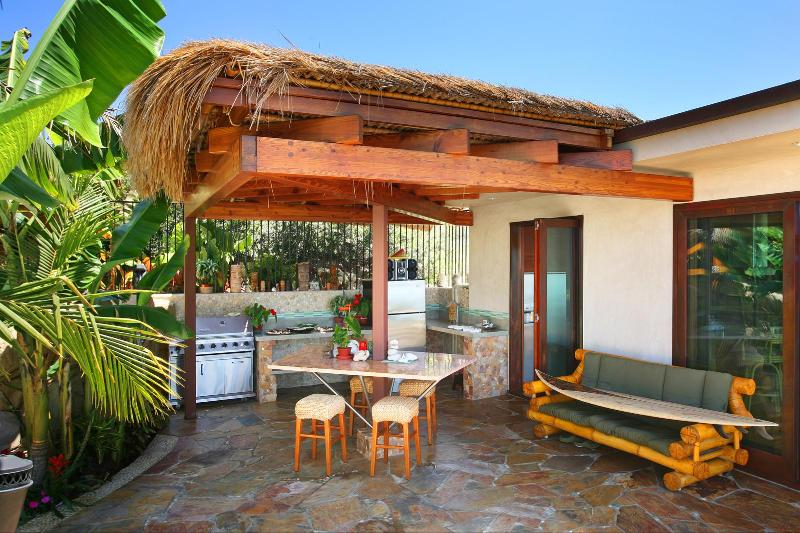 Outside palapa eating/ bbq ss fridge and granite counters and table for 8 people