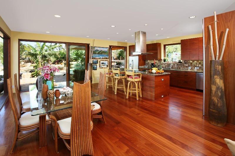 Dining,grt room, kitchen area w/ glass walls open to private tropical pool oasis
