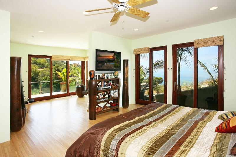 Grand master bedroom suite w/ king bed, ocean views, and private view decks