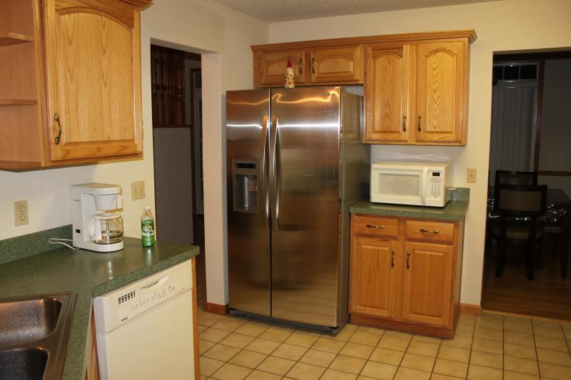 Kitchen with new stainless steel refrigerator and ice maker