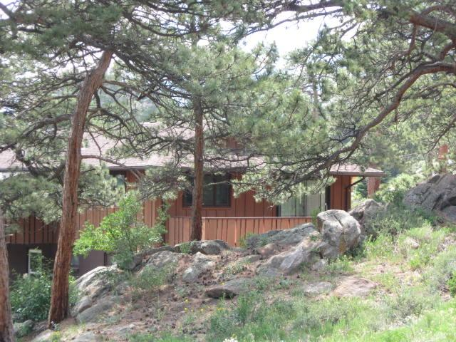 View behind the Cabin w/Private Deck off of the bedroom with a queen  bed, tv & large closet.