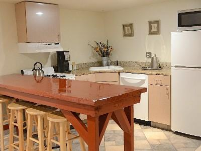 Full kitchen with stove, DW, refrigerator and microwave.
