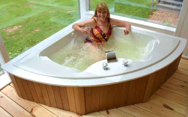 Large two person Jacuzzi spa in sunroom.