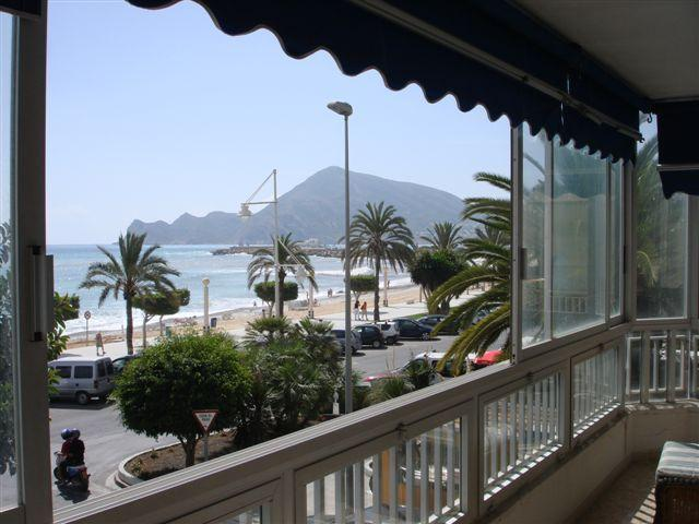 view from the balcony to the sea promenade and the beach