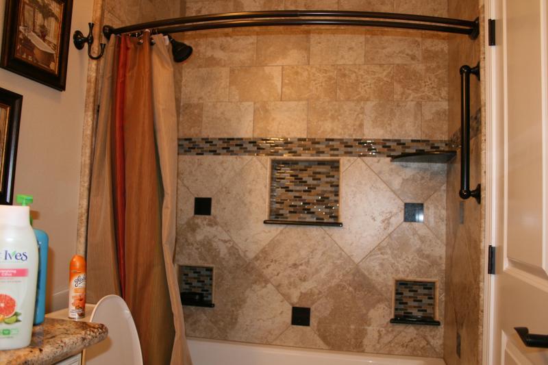 Newly remodeled bathroom has a Kohler soaking tub with granite wine-glass shelf.