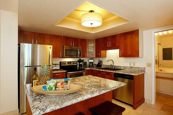 Full-equipped remodeled kitchen with granite counters and stainless steel appliances