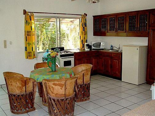 Complete kitchen with stove / oven, fridge, microwave, all pots and pans and silverware