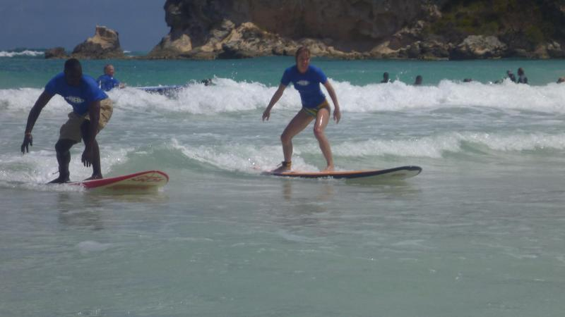 take some surfing lessons