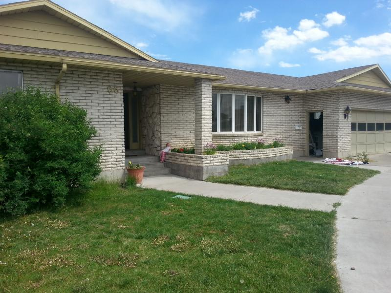 This charming white brick home, with circular drive, is right in the heart of Rexburg.
