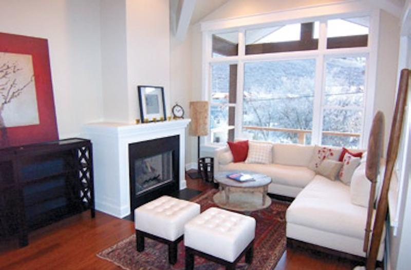 large living room with fireplace and 60' led tv