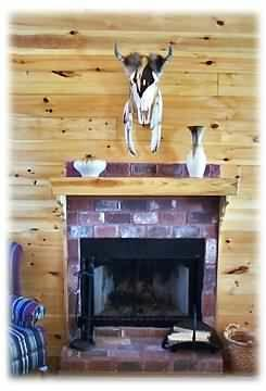Wood burning fireplace with local decor