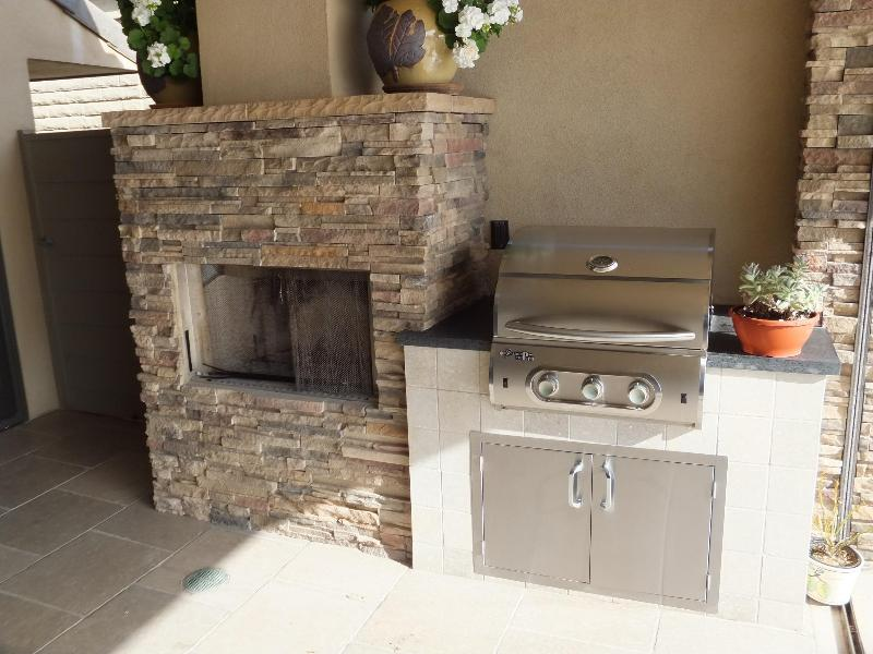 fireplace and barbecue grill on the patio
