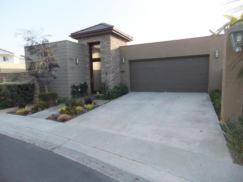 front of house-- Contemporary Craftsman style with garage. Extremely quiet location.
