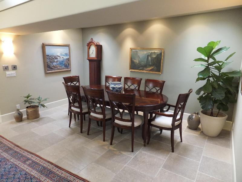 dining room open to kitchen. Furnished with antiques and plein air paintings.