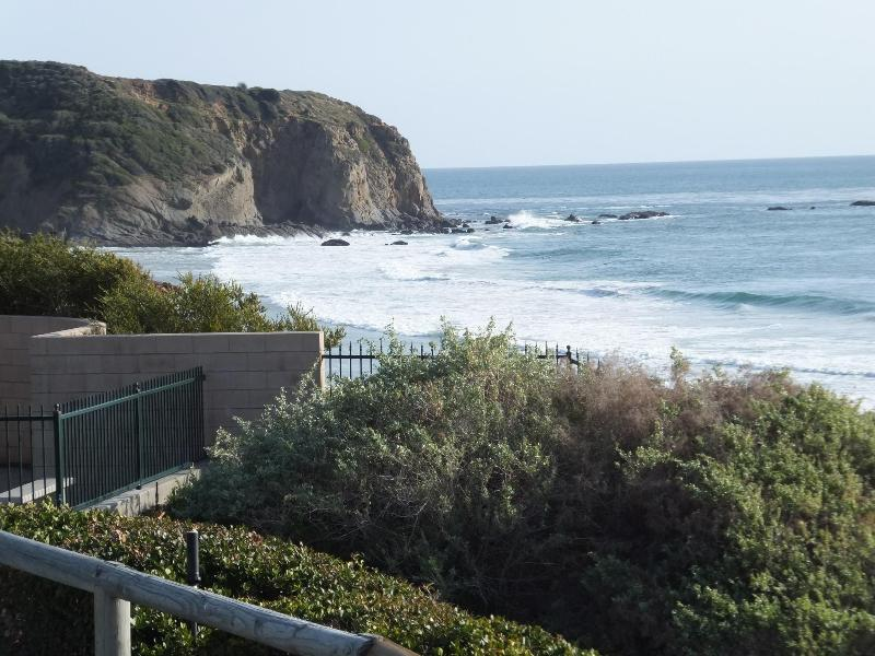 view from ocean bluff park. Land mass is Dana Point. One minute walk to the beach from here.
