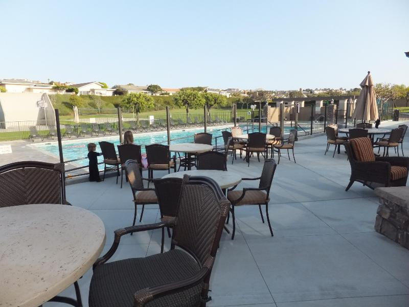 clubhouse outdoor seating with fireplace