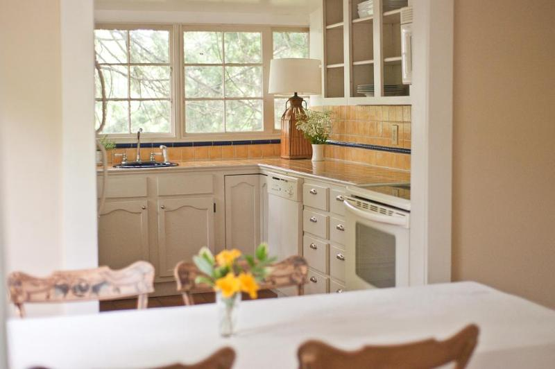 The kitchen is light filled, charming and well stocked!