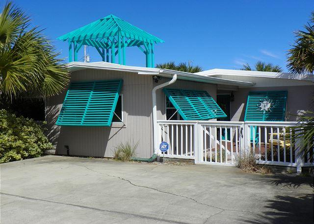 This home has great window shutters, a fenced front yard and great rooftop deck.