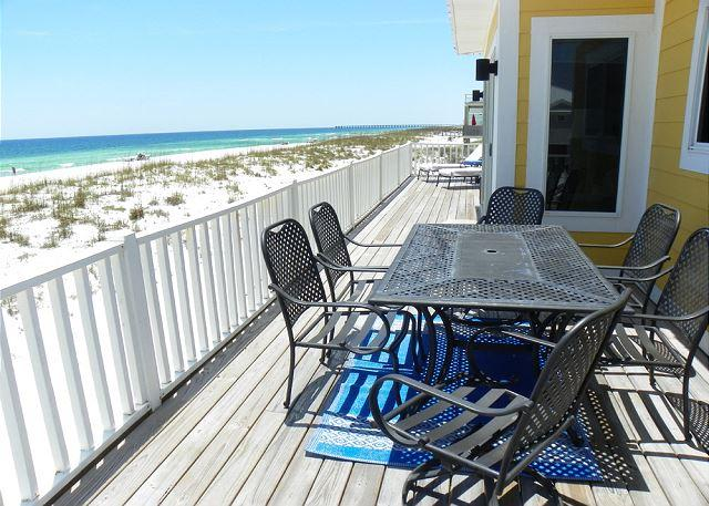 Enjoy family meals with a view on the gulf front deck.