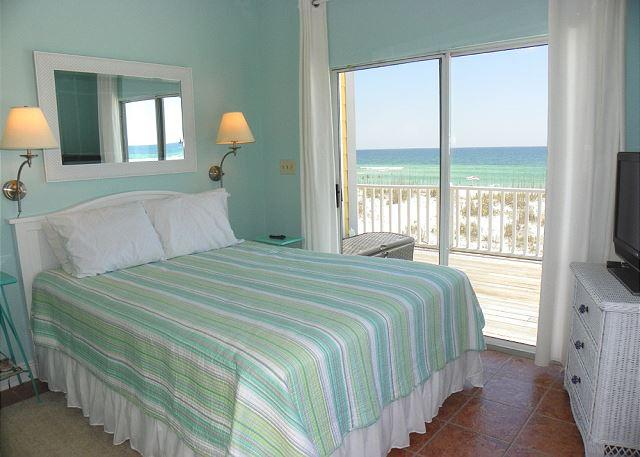 This gulf front bedroom has 1 queen bed, shares a hall bath with bedroom 2 and has access to the gulf front deck.